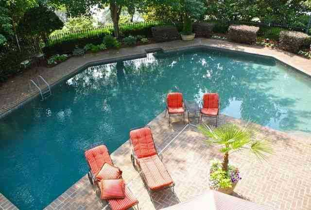 The home has a pool and lounge area.