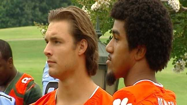 Clemson QB Cole Stoudt and DE Vic Beasley pose for pictures at the ACC Kickoff in Greensboro on Sunday.