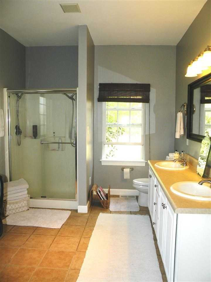 The master bath has a shower, tub and double vanity.