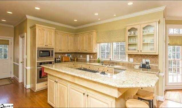 The large kitchen has granite countertops and a large island.