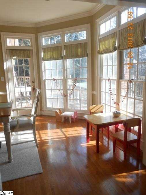 The kitchen features several windows that look out to the deck.