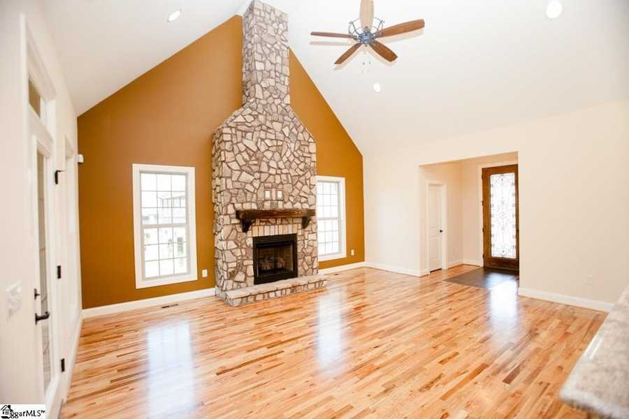The home features an open floor plan with a stone gas fireplace.