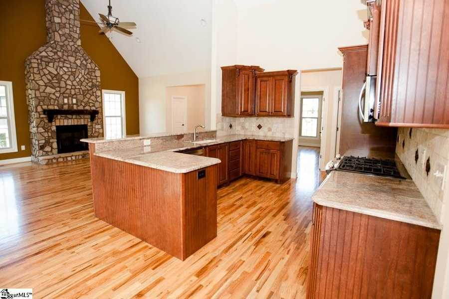 The kitchen offers granite countertops, stainless appliances, a gas stove, breakfast area and pantry.
