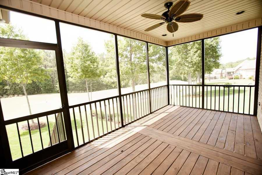 There are golf course views from the great room, kitchen, dining room and master bedroom. The home also has a screened porch, full yard irrigation and a security system.