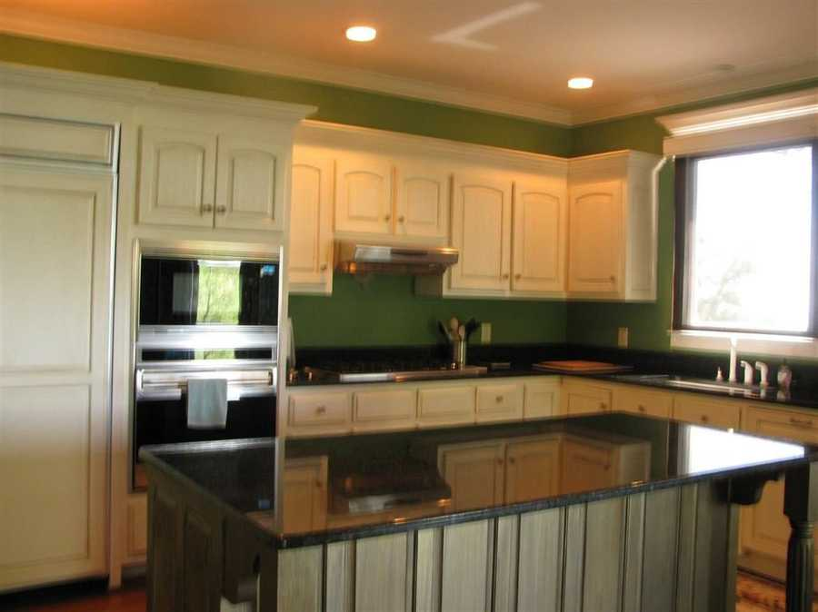 The kitchen has a large island and granite countertops.