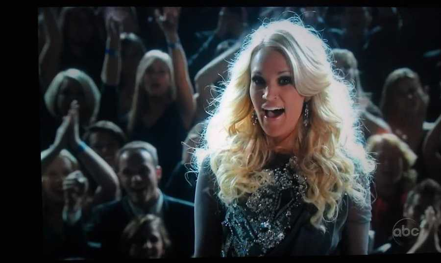 While in Nashville Chris attended the Country Music Awards and was caught several times on camera behind the singers.
