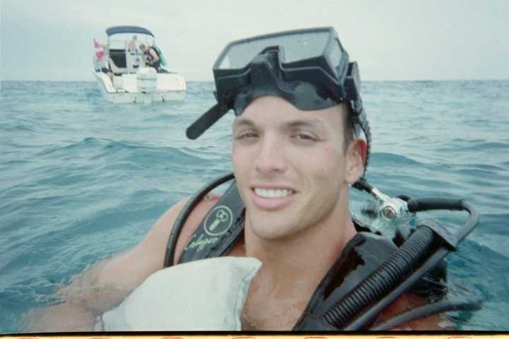 """Chris is an avid scuba diver. His favorite dive spot is called """"Hens and Chickens"""" in the Florida Keys."""