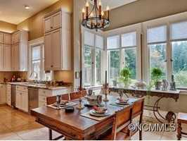 The thoroughly updated kitchen features Travertine tiled floors, granite countertops and Viking Professional appliances.