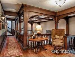 Ascending the grand staircase takes you to the homes 6 bedrooms, the nursery, and the home office.