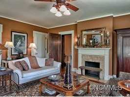 """Four of the six bedrooms feature full baths """"en suite"""" and two feature wood burning fireplaces."""