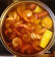 Frogmore Stew, also known as Low Country Boil, is named after the small community of Frogmore on St. Helena Island just off the S.C. coast. The dish's main ingredients are shrimp and corn on the cob, but potatoes, sausage and other shellfish are also added.