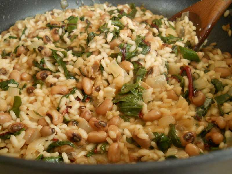 Hoppin' John is a dish made with black-eyes peas or field peas and rice with bacon or ham hock and chopped onions. Hoppin' John is traditionally eaten on New Year's Day and is thought to bring good luck for a prosperous New Year.