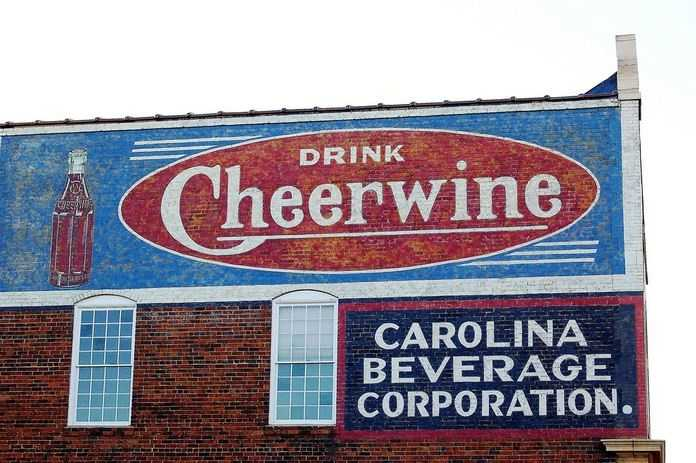 When the Maysville Syrup Company ofMaysville, Kentuckywentbankruptin 1917,L.D. Peelerand other invested businessmen moved the company to North Carolina and renamed it theCarolina Beverage Corporation.That same year, Peeler purchased a recipe for a cherry flavored soda from a Saint Louis flavor salesman, which eventually became Cheerwine.Though it had been around since 1917, Cheerwine first became a registered trademark in 1926.