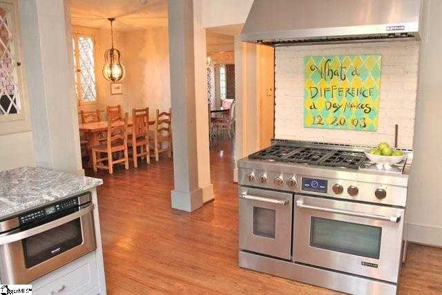The gourmet kitchen has been updated with top-of-the-line appliances.