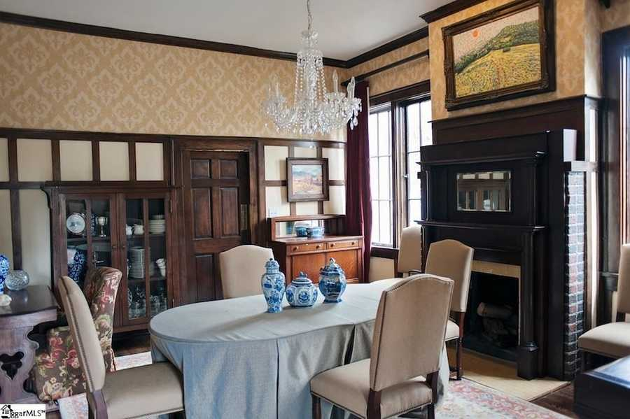 The dining room has the original chandelier and fireplace.