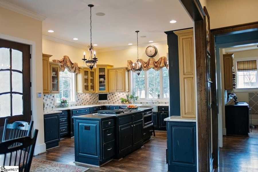 The kitchen features granite and marble countertops, stainless appliances.
