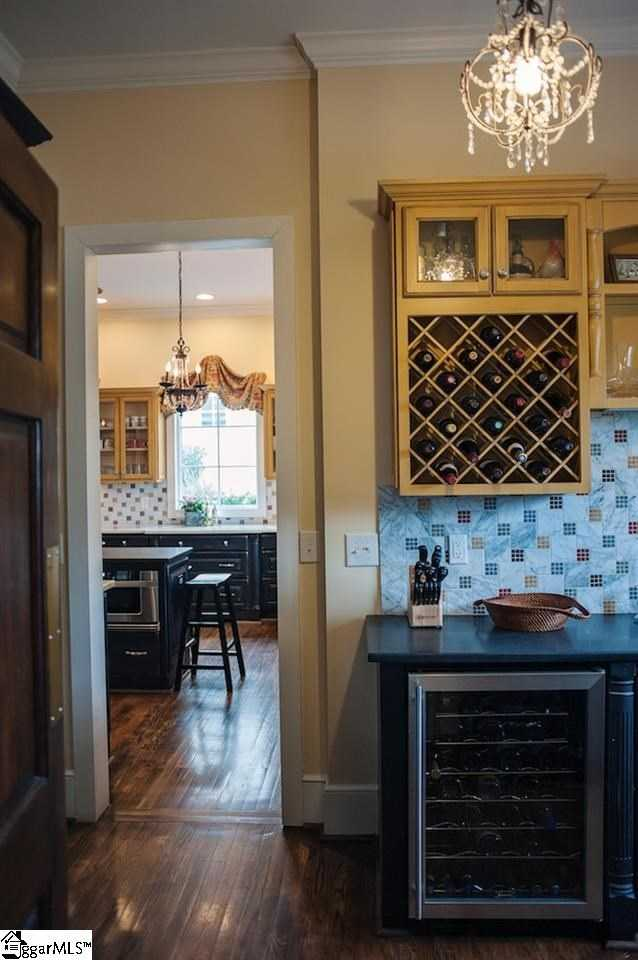 A butler's pantry off the kitchen has an icemaker, wine storage and a second dishwasher.