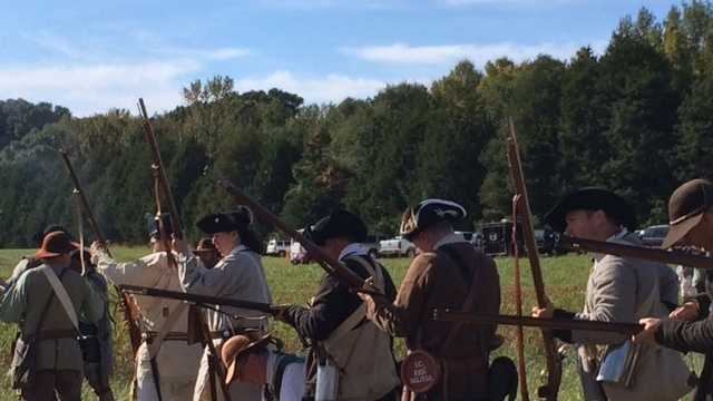 Reenactors used canons and period weapons to recreate the deadly raid by Loyalist partisan William Cunningham at Walnut Grove Plantation.