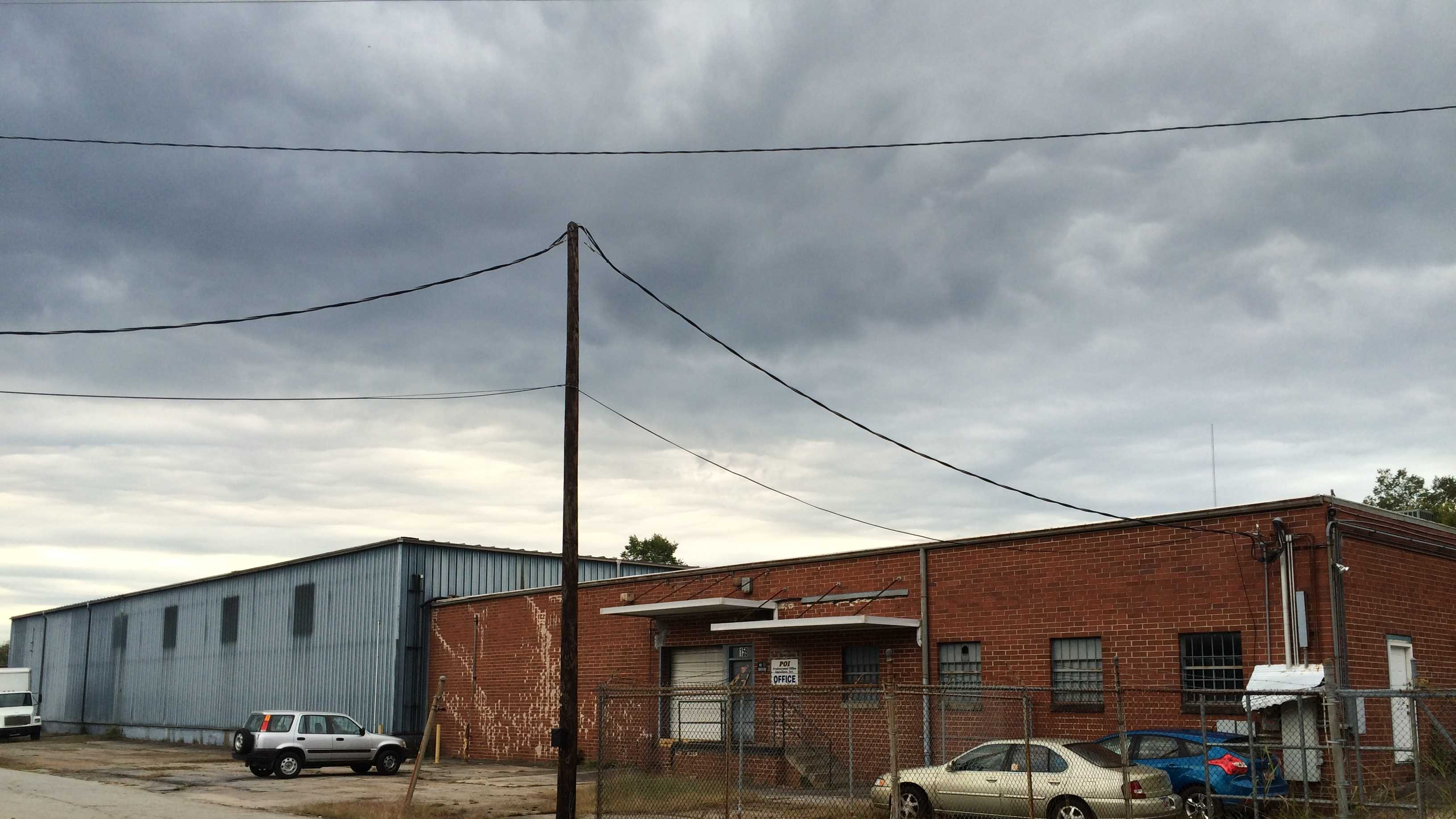 The city bought the blue warehouse and red brick building for demolition.