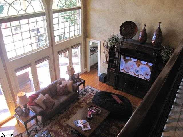 The living room has custom built in electronic blinds over massive windows.