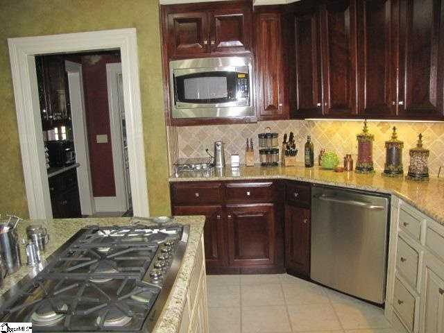 The kitchen features a floor-to-ceiling wine rack and a walk-in pantry and many upgrades.