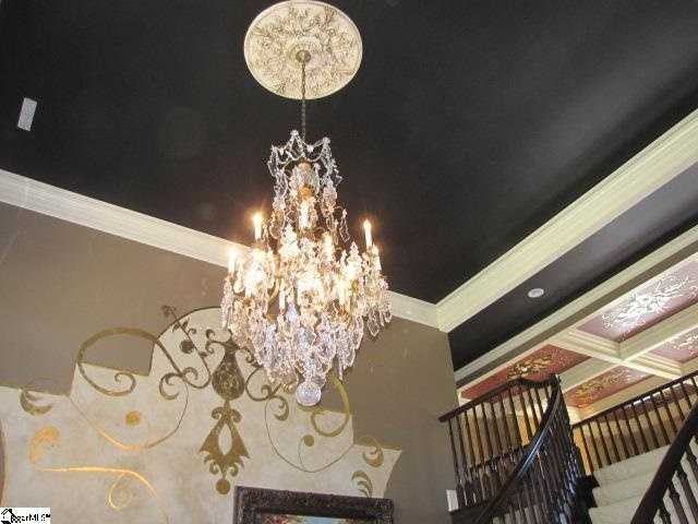 The entry features a 100-year-old Baccarat Chandelier valued at over $100,000 that can be raised and lowered electronically for easy cleaning.