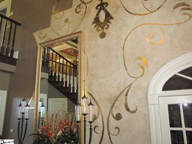 The owners spent more than $45,000 on custom wall and ceiling custom paint, several rooms with gold-leaf accents.