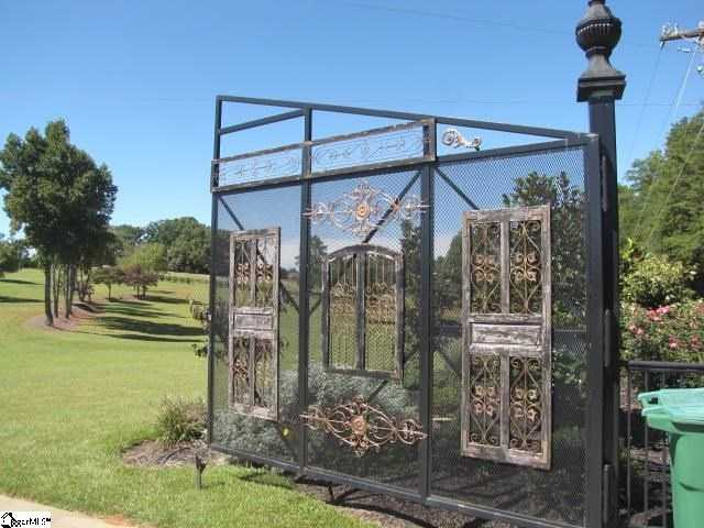 The home is accessible through massive 15-foot tall custom gates.