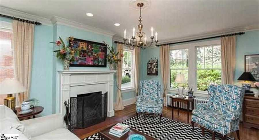 It has wide crown molding, wood burning fire places, hardwood floors and arched doorways.