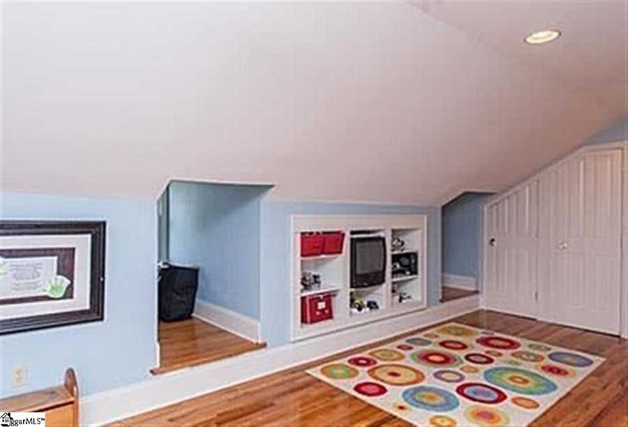 The third floor has a playroom with a bed and bath.