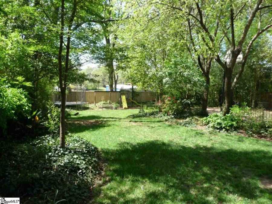 The backyard overlooks downtown Greenville. The lot is a third of an acre.