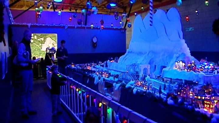 The Christmas-theme exhibit at the Miniature World of Trains features four model trains trekking through a snow-covered mountain town.