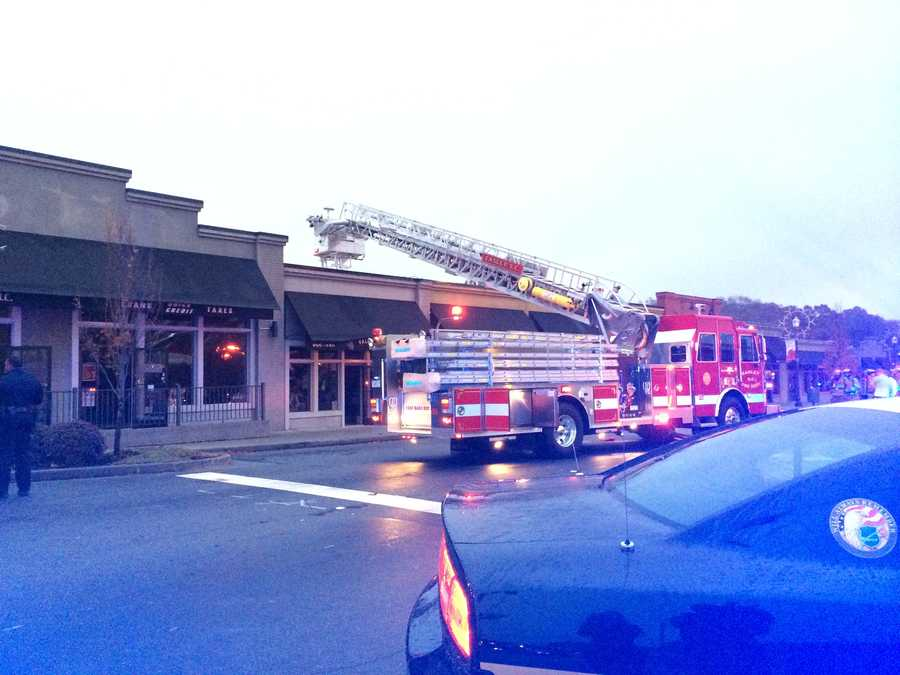 Crews blocked NE Main Street as they doused flames inside.