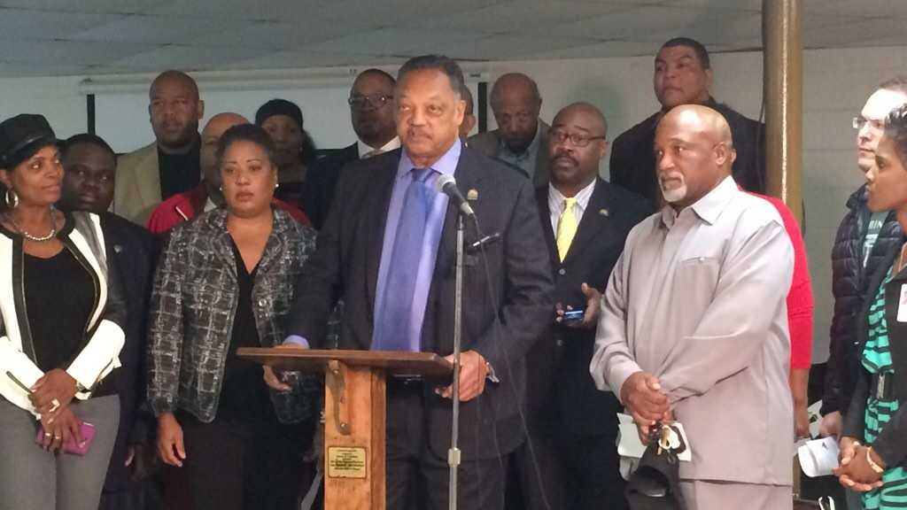 Reverend Jesse Jackson talks to community members at Springfield Baptist Church.