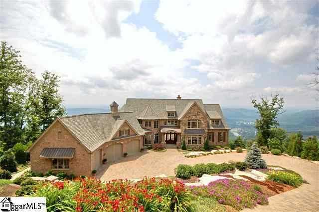 This six bedroom, six full/three half bath home is listed for sale on Realtor.com.