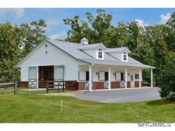 Equestrian amenities include 6-stall Morton barn with tack room, wash rack, equipment barn with loft apartment, outdoor ring and board-fenced pastures.