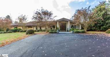 This custom contemporary home is listed for sale on Realtor.com.