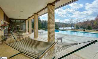 The lanai across the back of this home overlooks the 24' x 55' gunite pool.