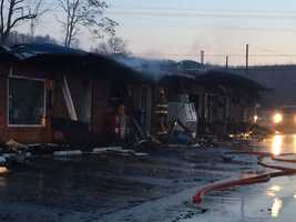 As the sun came up, smoke was still rising off the roof of the business.
