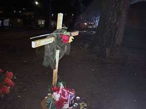 A cross is still set up at the home in honor of the shooting victim, 24-year-old Jeremy Burns.