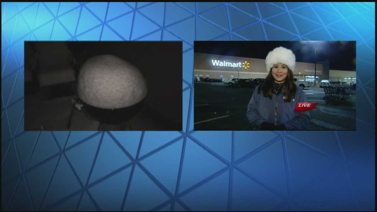 WYFF News 4 Meteorologist Pamela Wright compares the snow on her grill to News 4's Myra Ruiz's hat.