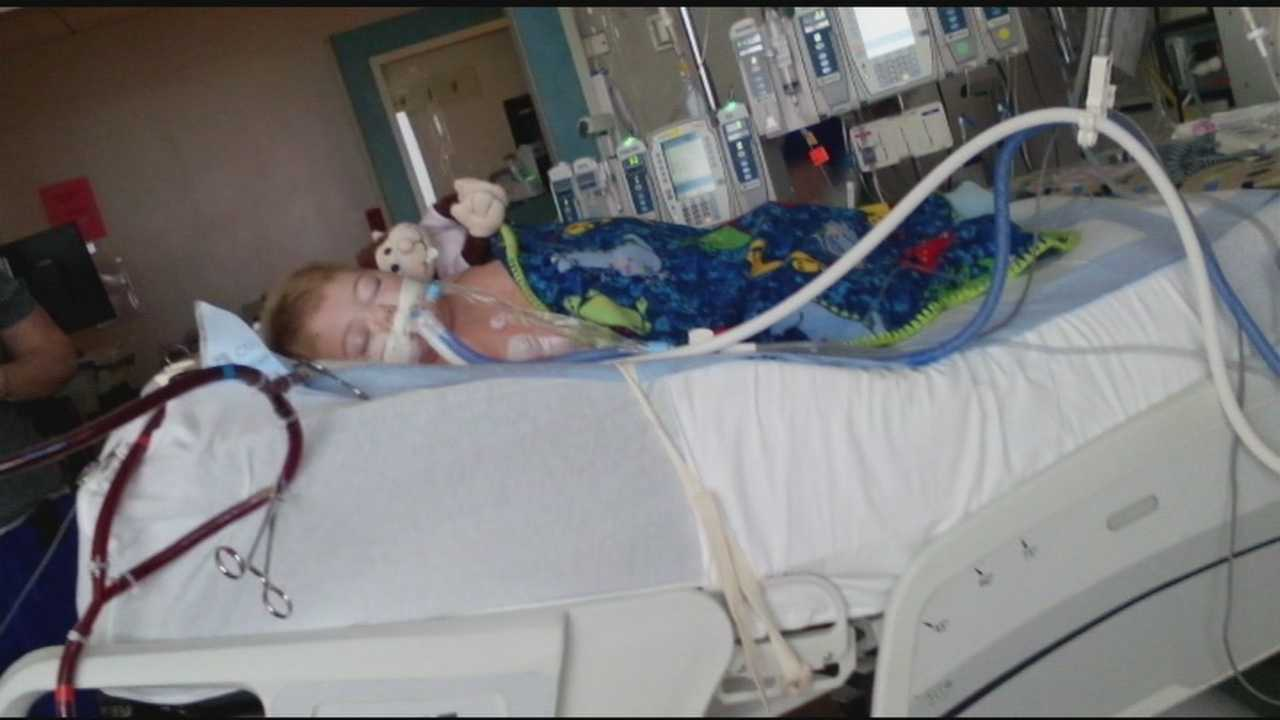 A Clinton toddler is fighting for his life after accidentally swallowing tiki torch fluid.