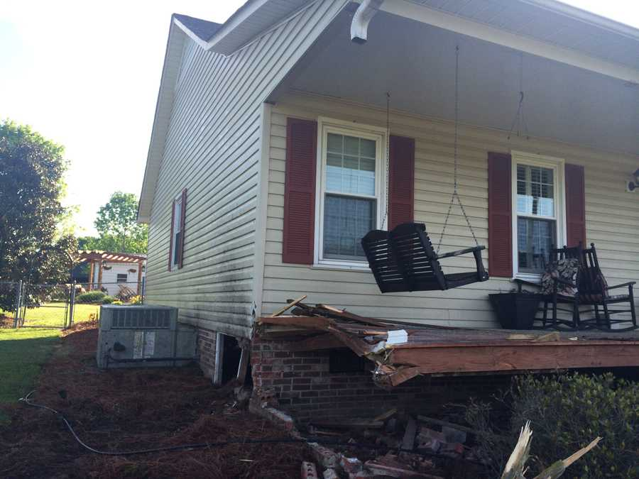 Two people had to be cut out of a vehicle after it crashed into a house in Anderson County, according to officials at the Wren Fire Department.