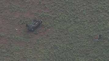A car has overturned in a field in Laurens County Tuesday morning.