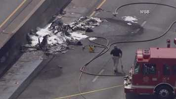 A fire officials say all four people on board a small plane that crashed into a busy Atlanta interstate have been killed.