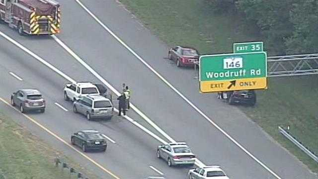 A wreck on Interstate 385 N at the Woodruff Road exit (exit 35) is slowed traffic and caused a backup Wednesday morning.