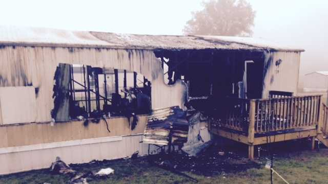 Fire burn a mobile home and sent an elderly woman to the hospital early Tuesday.
