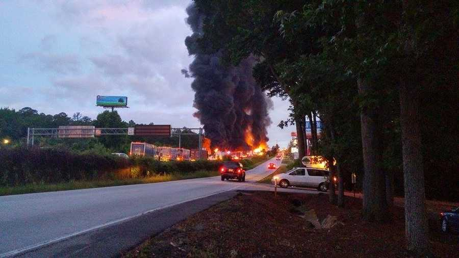 A fiery wreck involving a gasoline tanker shut down traffic in both directions early Wednesday.