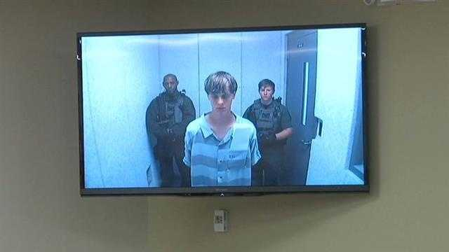 Dylann Roof appears in court to hear his official charges. Bond was set for $1 million dollars on the weapons charge.