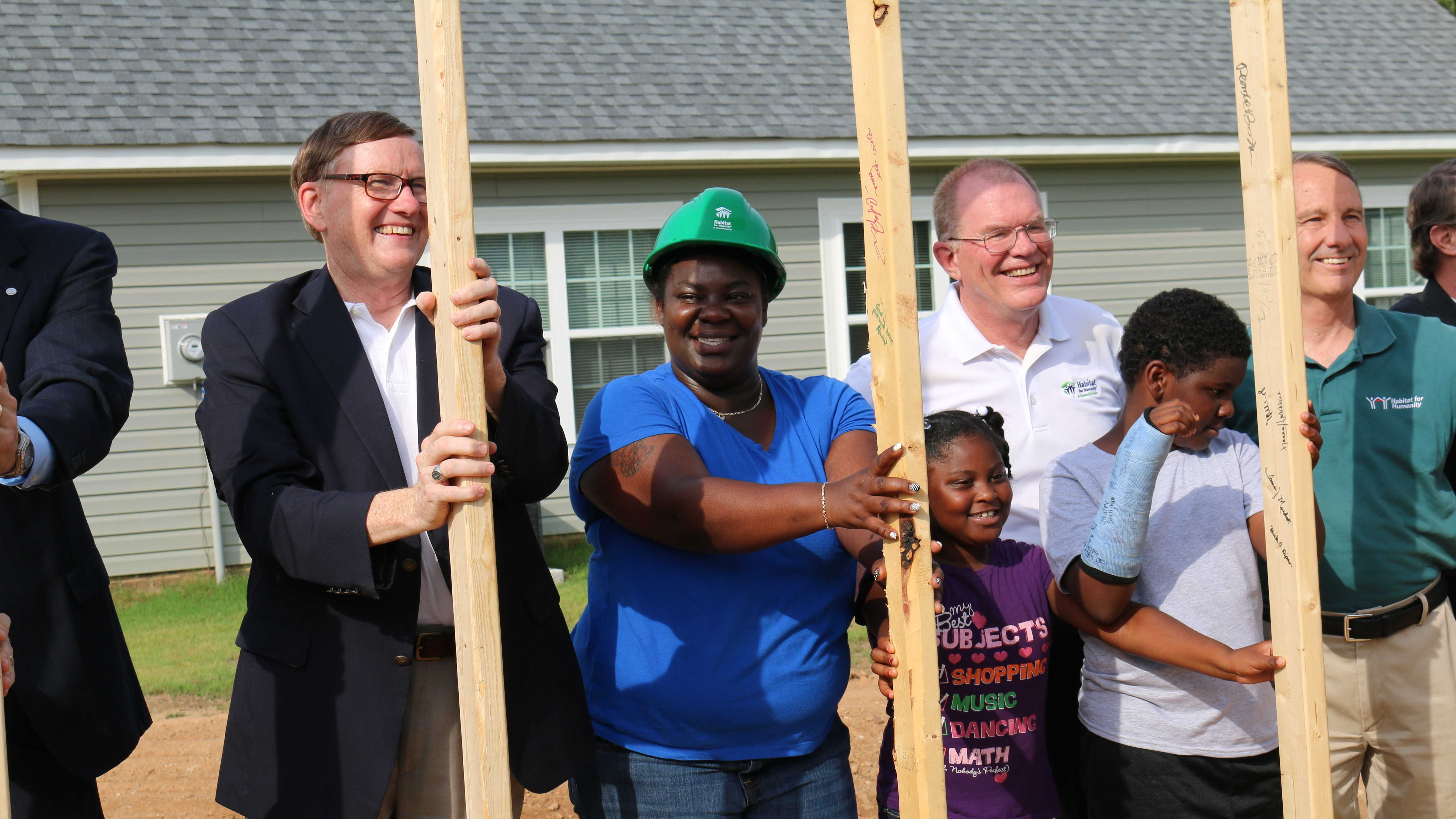 Homeowner Stacey Greene attends the wall-raising ceremony for her Habitat for Humanity house.